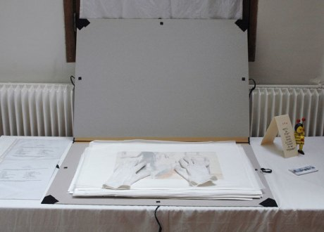 portfolio with gloves and drawings